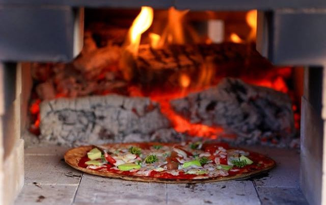 enjoy pizza baked on site by Community Garden volunteers