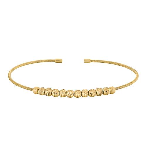 Bella Cavo Gold Tone Flexible Ball Bracelet