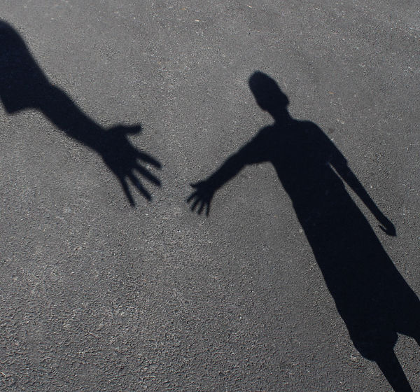 Helping Hand with a shadow of an adult h