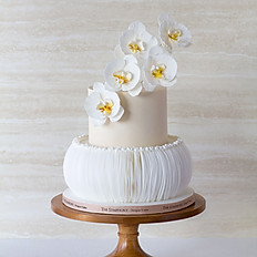 White Orchids with White Vertical Ruffle Wedding Cake