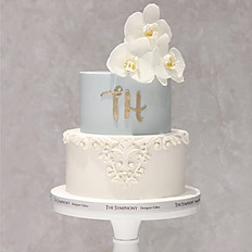 White orchid with White Baroque Embellishment Wedding Cake