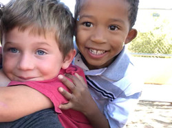2 kids smiling at school