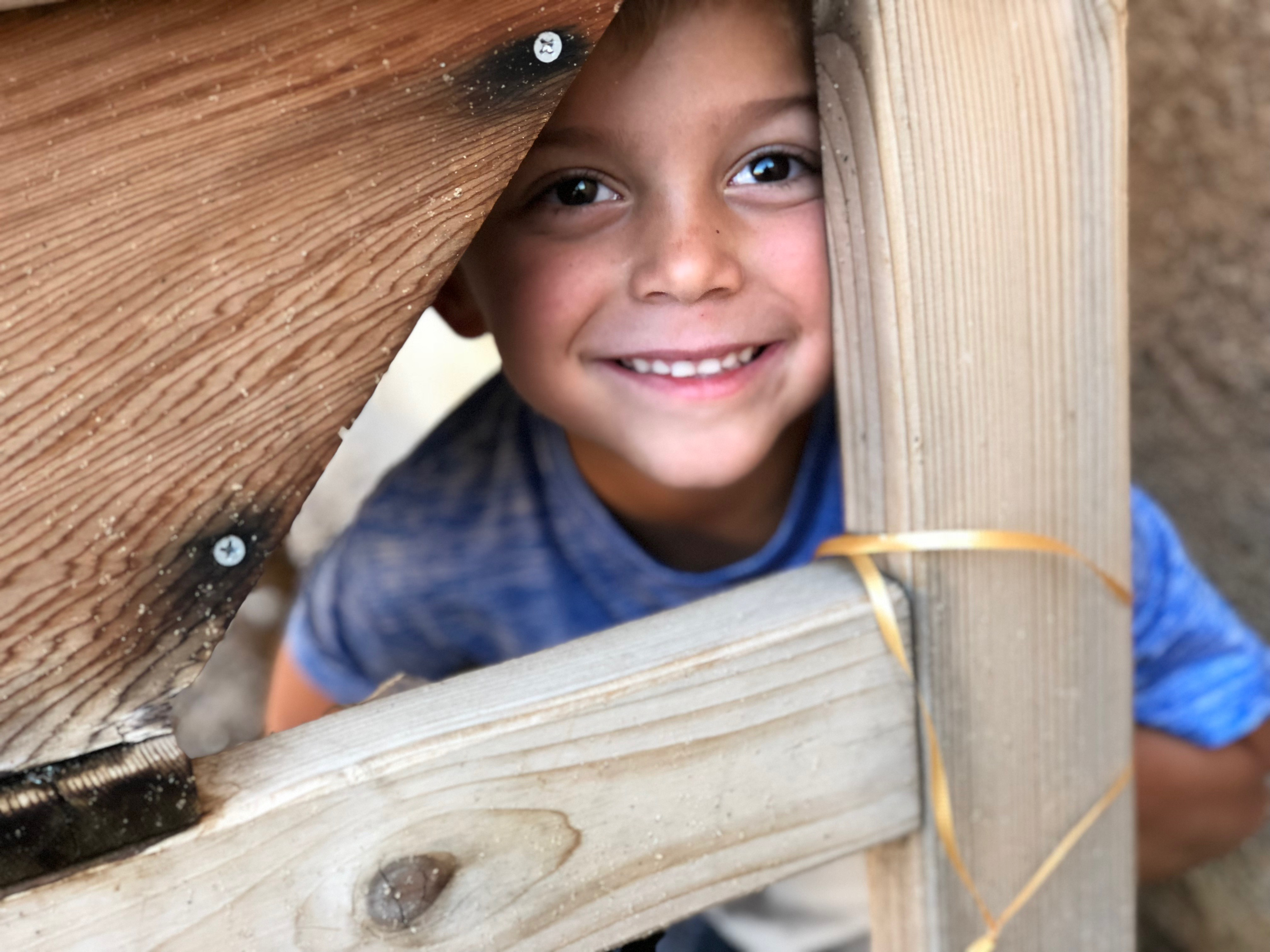 Kid hiding and smiling