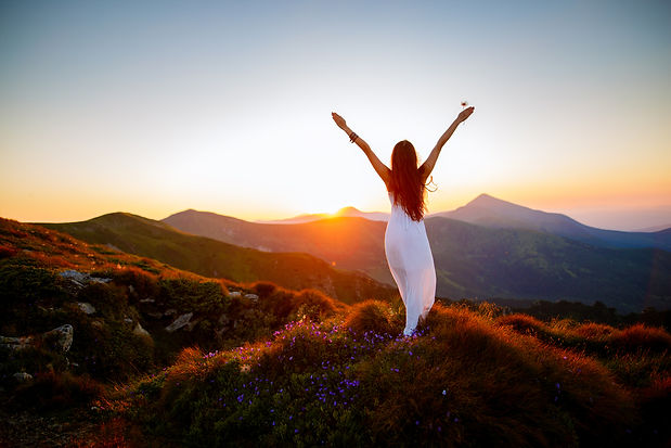 Happy Woman With Mountains in the background