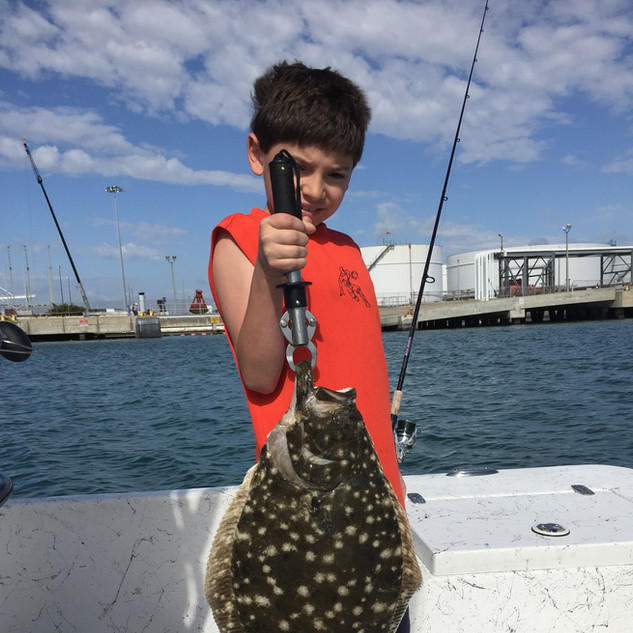 kid holding fish he caught