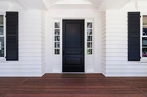Front Door with window frames next to it