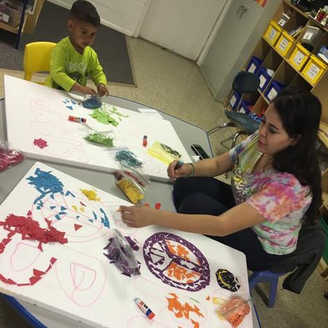 teacher helping student paint