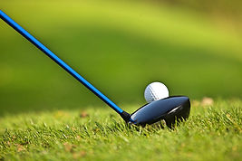 golf club getting ready to hit a golf ball