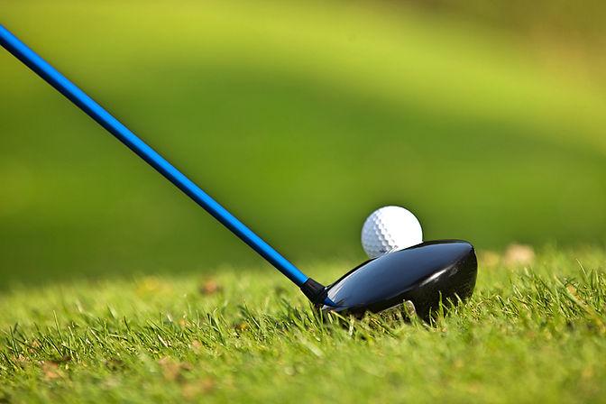 Golfer hitting golf ball
