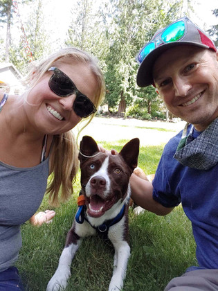Sparky with new owners.JPG