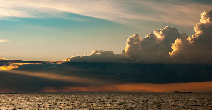 ship-crossing-ocean-in-a-sunset-with-sun