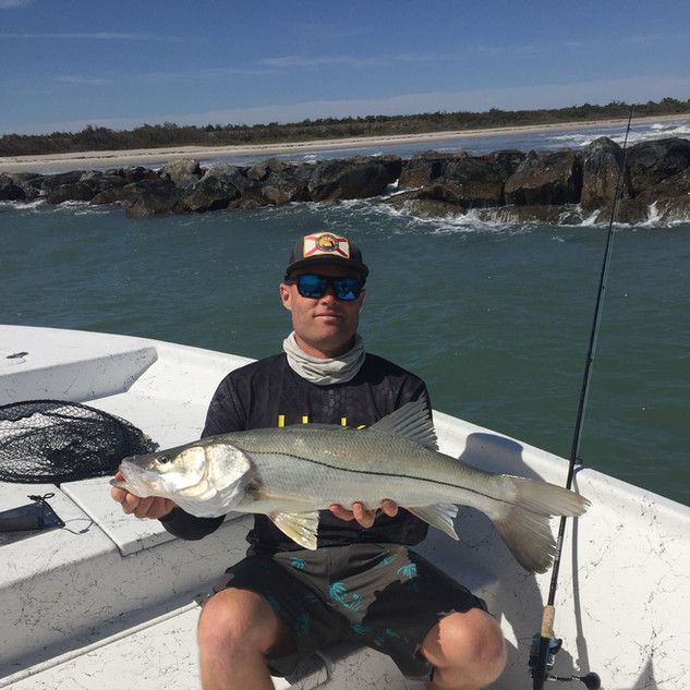 guy sitting with fish he caught