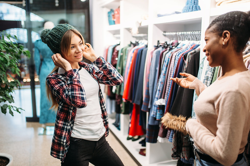 two-females-buying-clothes-in-shop-shopp