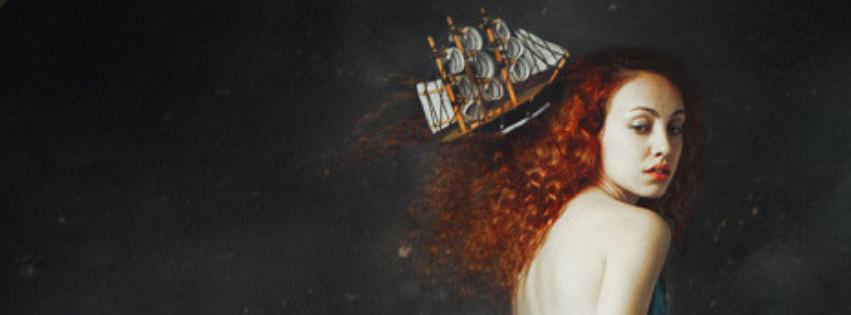 onirico ritratto di ragazza con barca tra i capelli