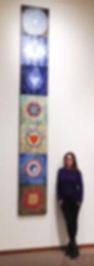 Me with chakra paintings.jpg