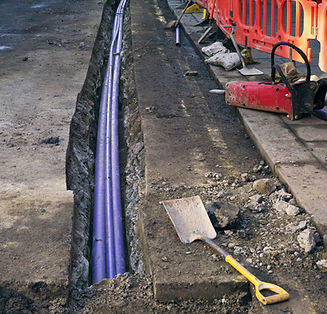 groundworks blue drain pipe being laid