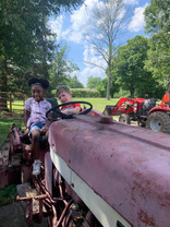 playing on the tractor