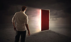 a-man-walks-up-to-an-open-door-with-brig