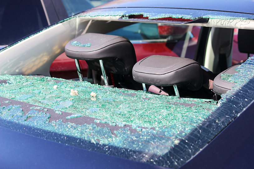 Rear windscreen of car smashed up, windo