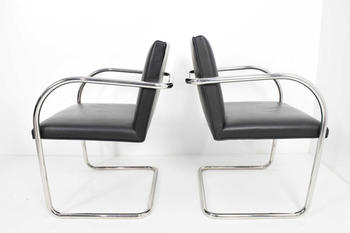 Pair Of Knoll Brno Chairs In Black Leather Designed By Mies Van Der Rohe.  Chairs Are Stainless Steel So Metal Can Be Polished If Scratched.