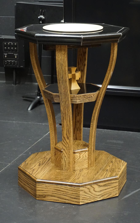 Baptismal font with bent legs