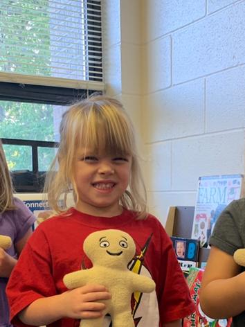 preschool playing dolls