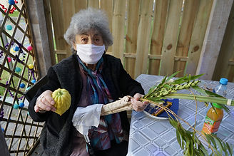 Senior in mask with lulav