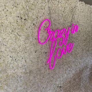 Neon crazy in love flower wall.jpeg