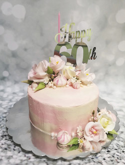 Buttercream finish with sugar flowers and meringues