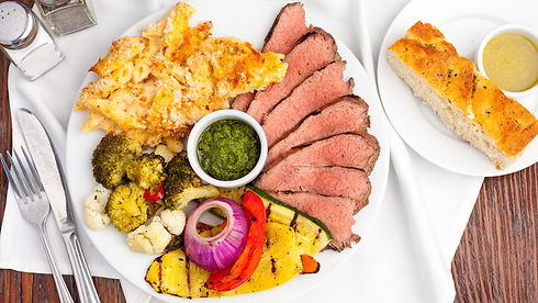 Tri Tip entree served with Mac & Cheese, grilled veggies, and housemade chimichurri sauce