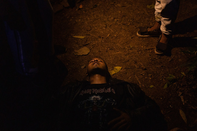 Thiago Martins, an indigenous of the Guarani people, lies in the middle of the forest to rest after putting out the fires at Jaraguá Indigenous Land in Sao Paulo, Brazil, June 21, 2020.