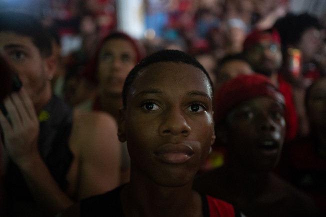 "A crowd of Flamengo fans watching Flamengo verses Liverpool during the final match of FIFA Club World Cup at the fan club ""Raça Rubro-Negra"" headquarters in Rio de Janeiro, December 21, 2019"