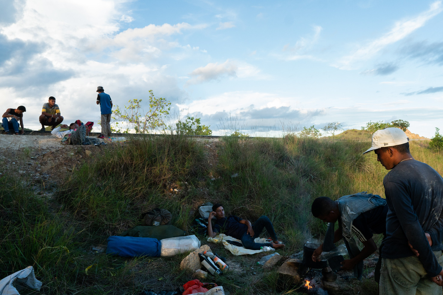 Venezuelan immigrants resting during crossing from Pacaraima city to Boa Vista, capital of Roraima state, on a journey of approximately 133 miles (214 kilometers) walking through the BR-174 highway. Brazil, July 16, 2019.