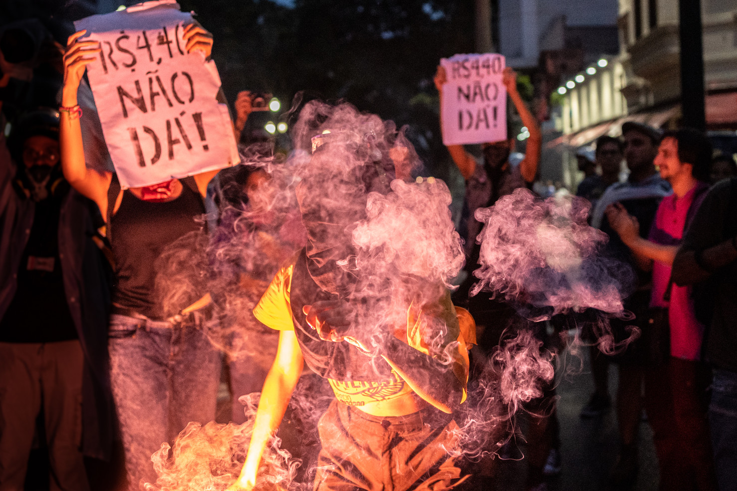 "Demonstrators hold up little flares and a signs that reads ""R$ 4,40 no way"" during the second day of protests against the fare hikes for public transportation in Sao Paulo, Brazil, January 09, 2020."