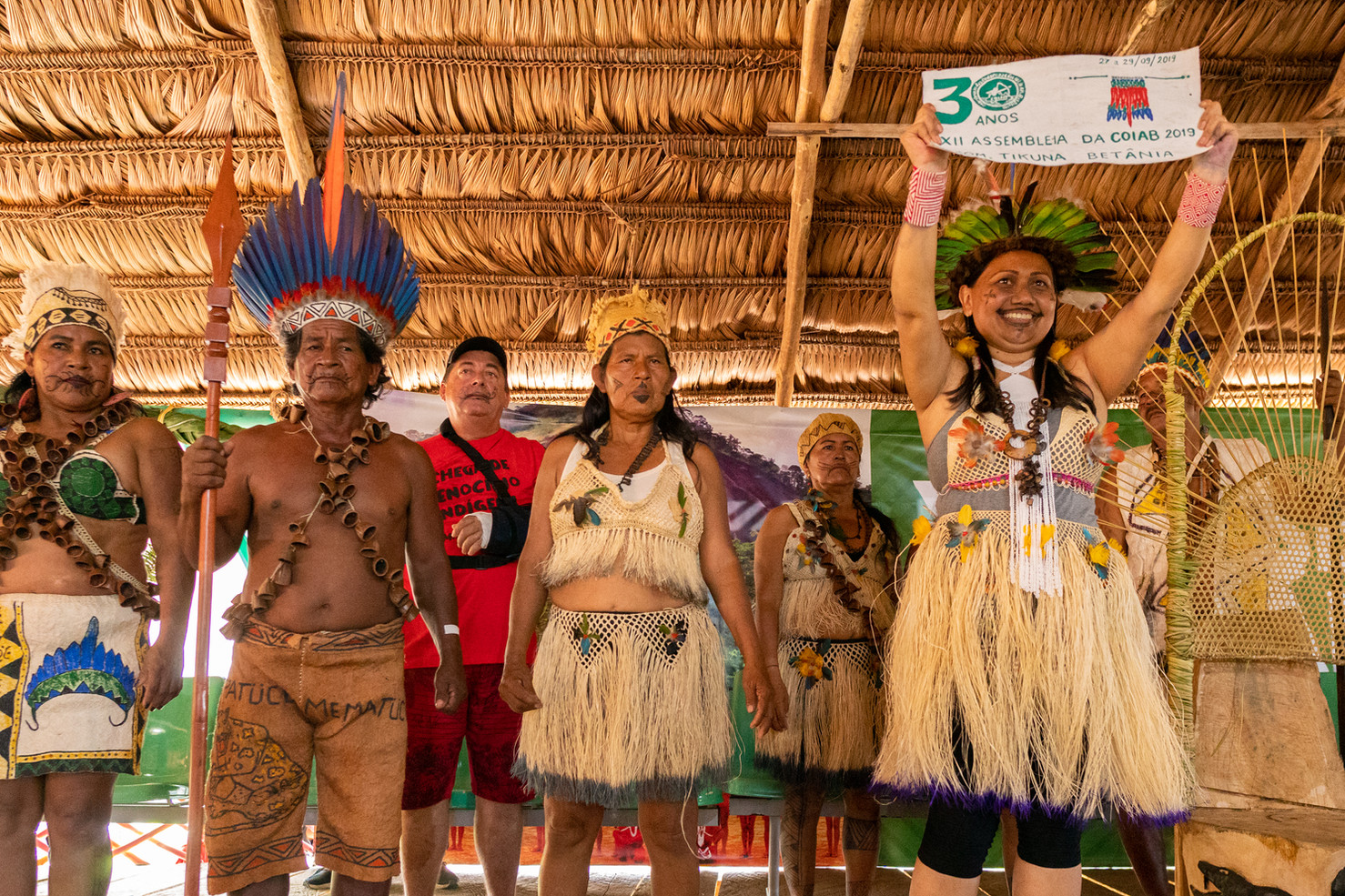 COIAB coordinator Nara Baré, alongside indigenous leaders from the local community during the opening ceremony of the 12th Ordinary Assembly of COIAB (Coordination of Indigenous Organizations of the Brazilian Amazon) marking the organization's 30th anniversary in Santo Antonio do Iça, Amazonas state, Brazil, September 2019. Around 300 indigenous leaders gathered to reaffirm the 519 years of resistance in the struggle to ensure and strengthen the rights to their territories and the right to preserve their cultures. This event takes place every two years.