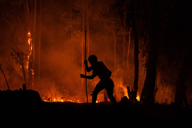 Indigenous of the Guarani people work to put out a fire near the village at Jaraguá Indigenous Land in Sao Paulo, Brazil, June 21, 2020.
