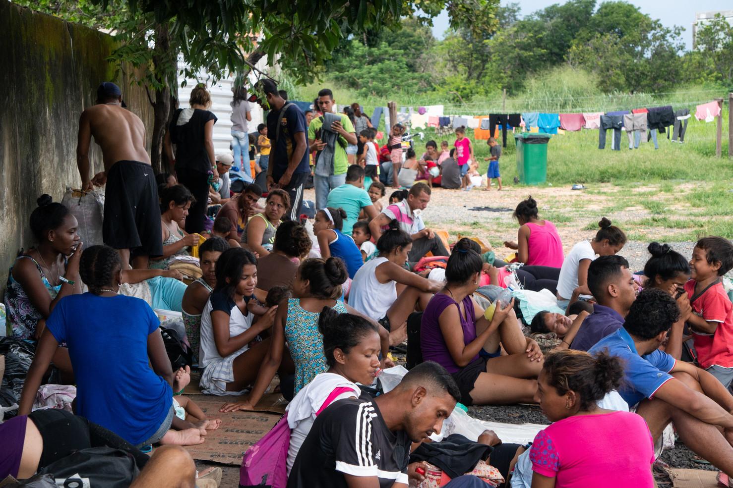 Dozens of homeless Venezuelan immigrants await food in a vacant lot in Boa Vista capital, Roraima state, Brazil, July 2019.