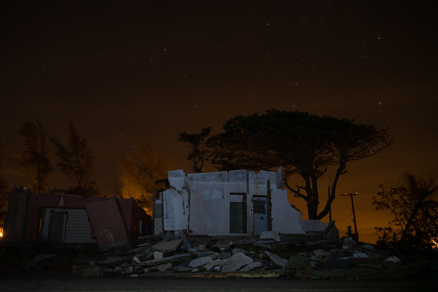 Destroyed houses are seen on East beach during a starry night in Ilha Comprida, Sao Paulo state, Brazil, February 19, 2020.