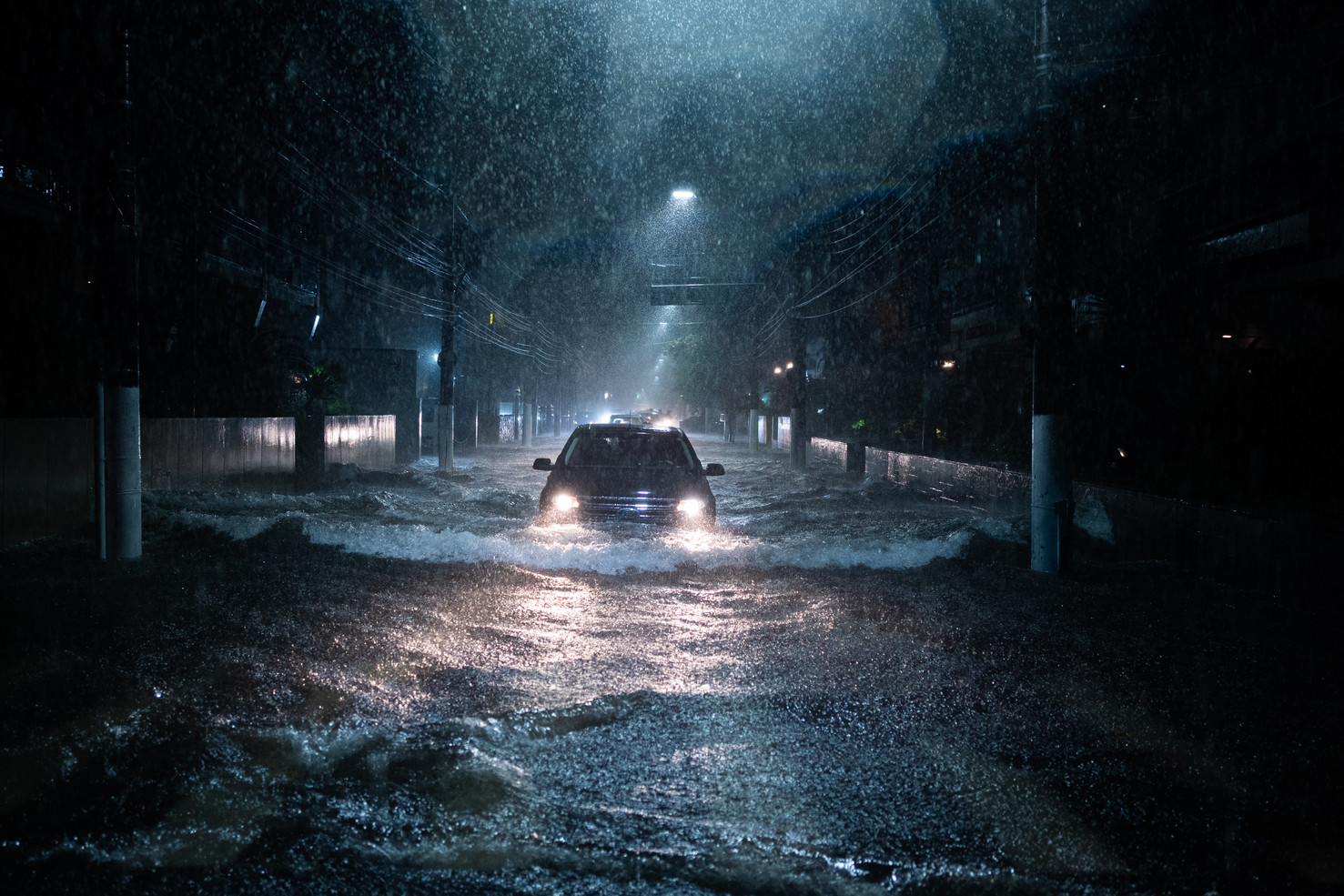 A car crossing a flood point in Santos, Sao Paulo, Brazil, during the heavy rainy night on March 2, 2020.