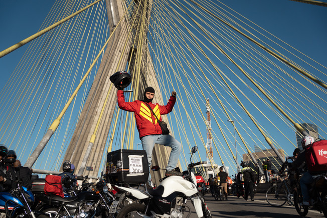 A demonstrator stands on a motorcycle as he protests during strike to demand better pay and working conditions for Brazilian delivery workers for apps amid the coronavirus disease (COVID-19) outbreak, in Sao Paulo, Brazil, July 1, 2020.