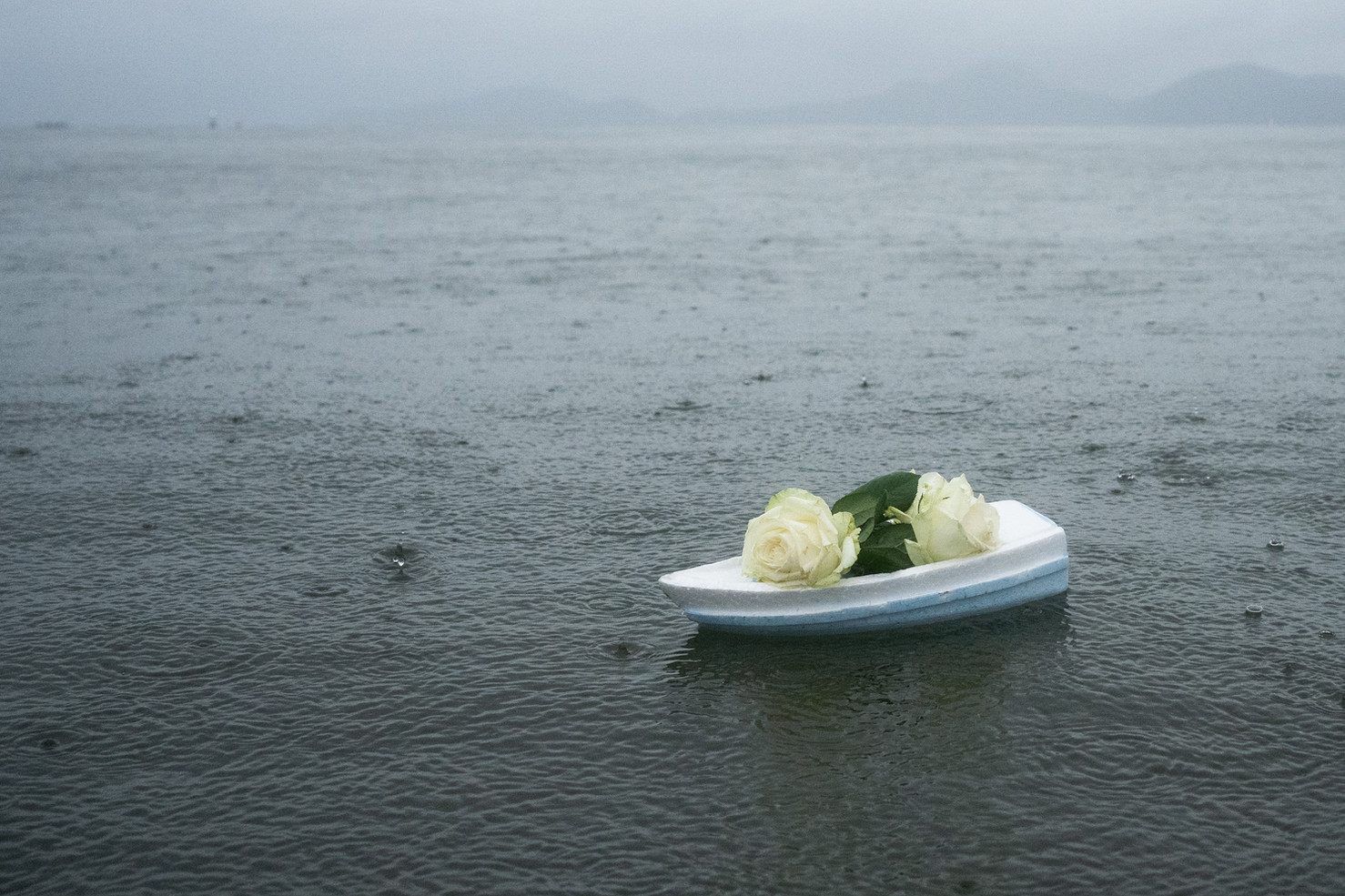 A little styrofoam boat with white roses was seen at sea during Iemanja Day (goddess of the sea) in Santos, February 2, 2020.