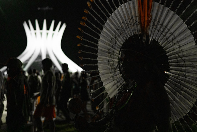 Indigenous are seen marching in order to create a vigil in front of the Supreme Federal Court as protest against the repossession of property moved against the Xokleng indigenous people during the XV Acampamento Terra Livre (Free Land Camp), the largest indigenous meeting in the world, in Brasilia, Federal District, Brazil, April 24, 2019.
