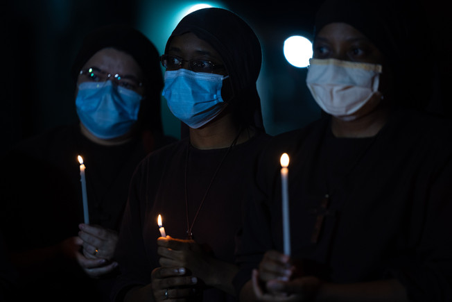 Franciscan missionary nuns pray during a procession for Our Lady of Fatima on her feast day amid the coronavirus disease (COVID-19) outbreak in Santos, Brazil, May 13, 2020.