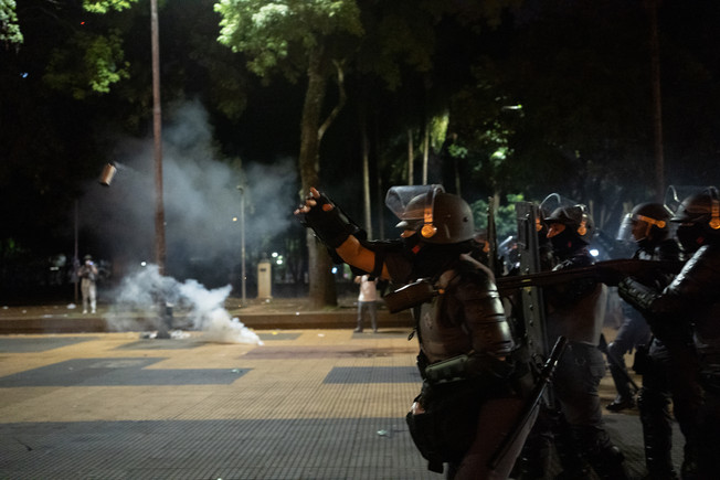 Riot police throws a tear gas bomb as they avance against demonstrators during a clash in a protest against fare hikes for public transportations in Sao Paulo, Brazil, January 9, 2020.