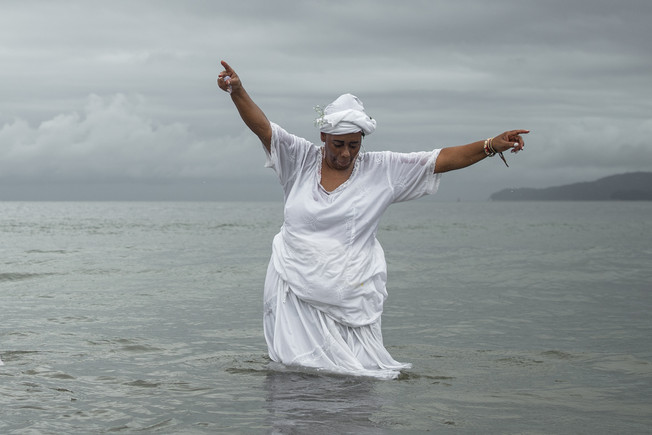 Devotees dress in white and gather on the beach to deposit offerings and ask for health, happiness and luck in love and work during goddess of the sea Iemanja Day in Santos, February 2, 2020.