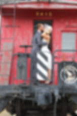 Steinke-Houim caboose kiss.jpg