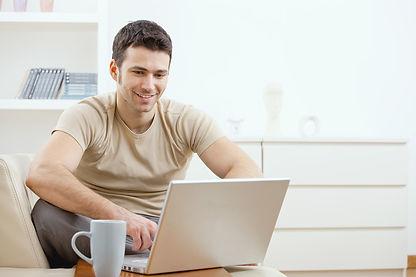 Man enjoying computer interaction over coffee