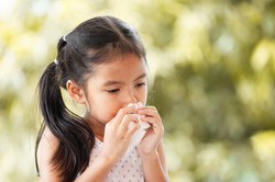 Sick asian little child girl wiping and