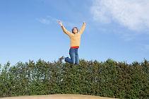 happy-woman-jumps-on-trampoline.jpg