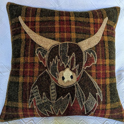 Cow on red/gold/green tartan
